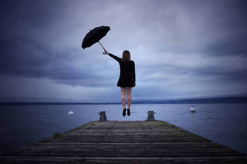 Delphine Millet Envol - Staged photography delicate sensitive surrealist lake mary poppins umbrella flying dream believe - Art conceptual photographer in Berlin