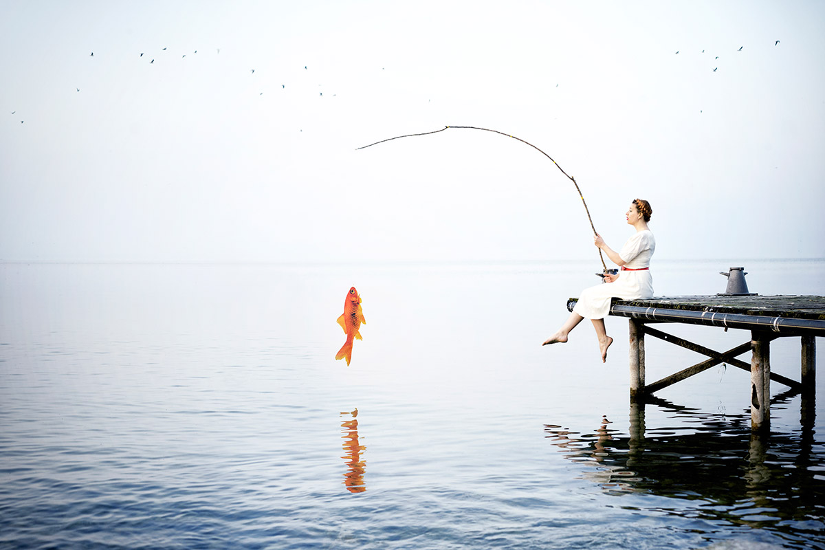 Delphine Millet Fish in the sea - Staged photography delicate sensitive surrealist minimalist lake goldfish humor funny - Art conceptual photographer in Berlin