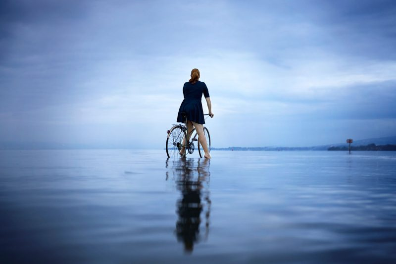 Delphine Millet You can go anywhere - Staged photography delicate sensitive surrealist lake bike possible impossible dream believe - Art conceptual photographer in Berlin